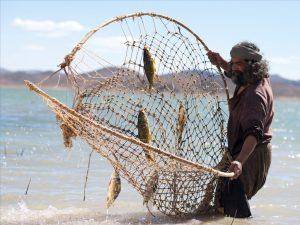Fiskare med nät